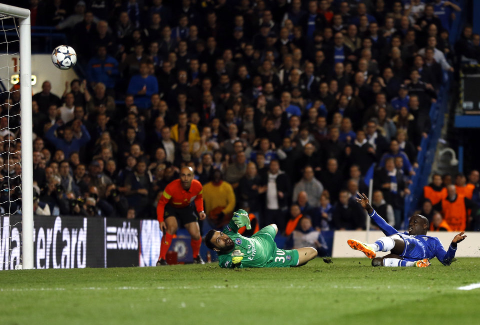 Photo - Chelsea's Demba Ba scores his side's 2nd goal during the Champions League second leg quarterfinal soccer match between Chelsea and Paris Saint-Germain at Stamford Bridge Stadium  in London, Tuesday, April 8, 2014. (AP Photo/Kirsty Wigglesworth)
