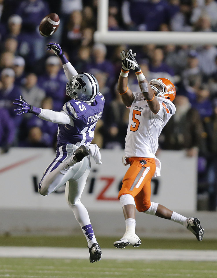 Photo - Kansas State's Randall Evans (15) breaks up a pass for Oklahoma State's Josh Stewart (5) during the college football game between the Oklahoma State University Cowboys (OSU) and the Kansas State University Wildcats (KSU) at Bill Snyder Family Football Stadium on Saturday, Nov. 1, 2012, in Manhattan, Kan. Photo by Chris Landsberger, The Oklahoman