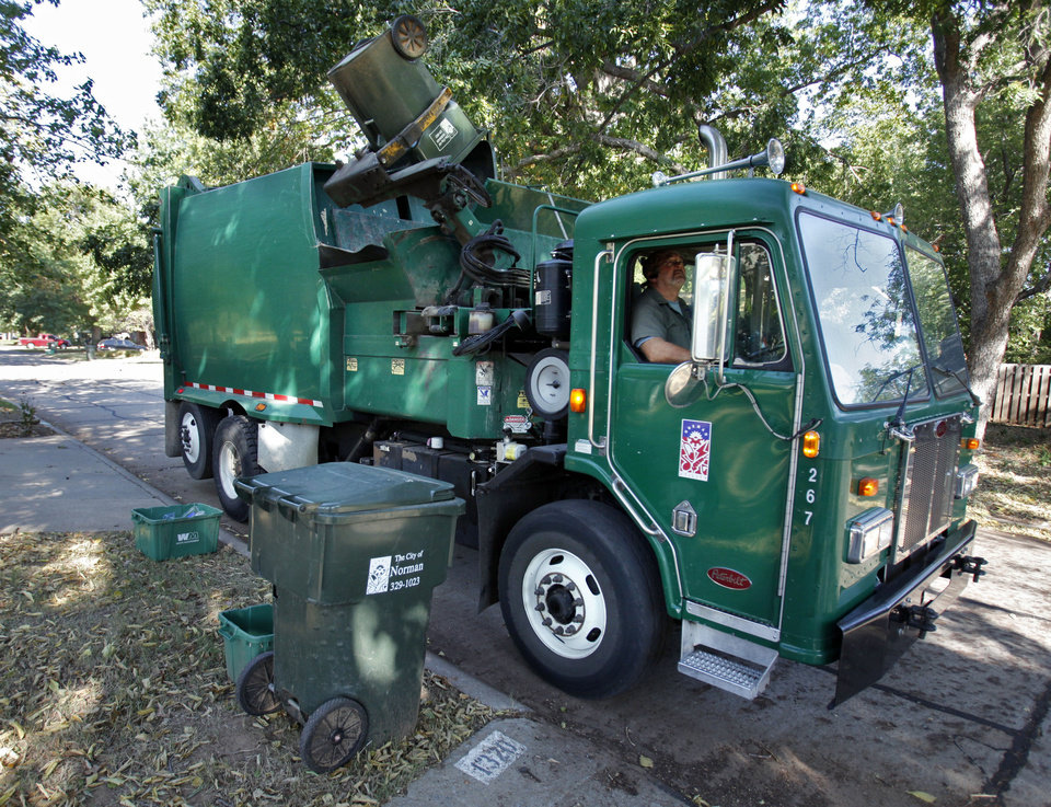 City crews collect trash Tuesday on a regular work day in Norman. Crews will begin working overtime Saturday to collect large trash items not allowed on regular trash collection days. PHOTO BY STEVE SISNEY, THE OKLAHOMAN