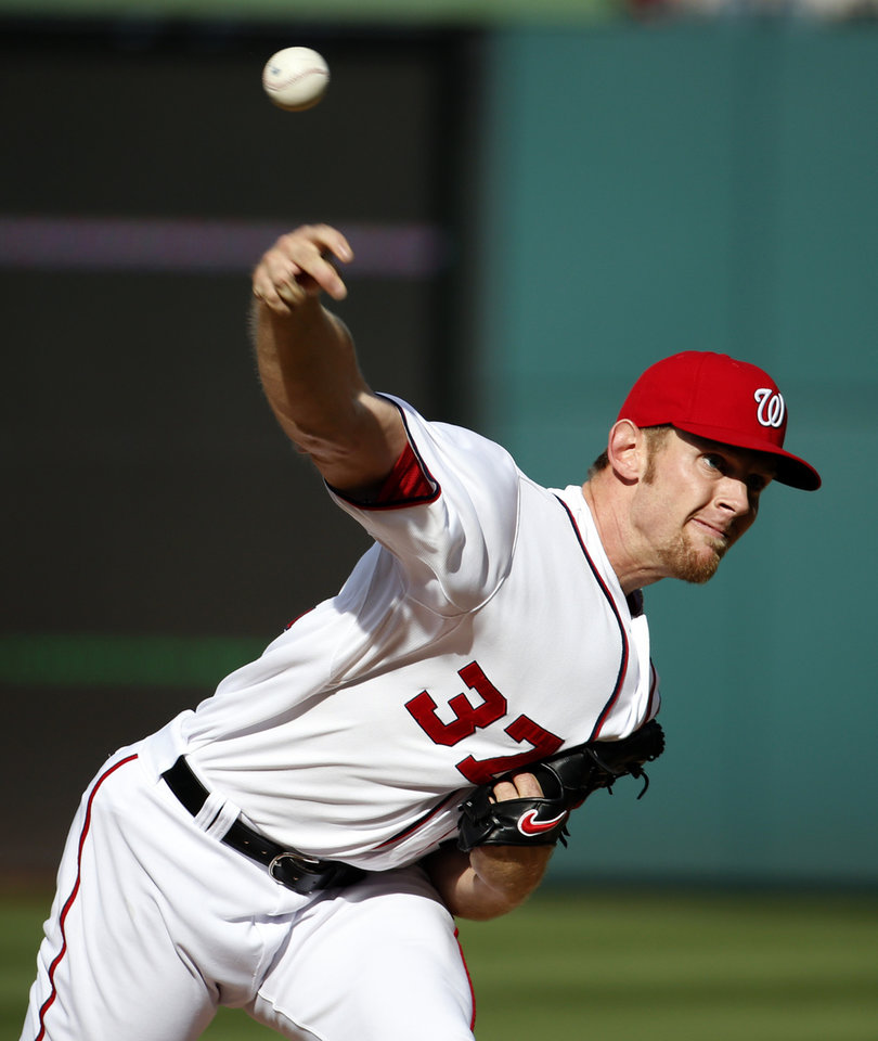 Photo - Washington Nationals starting pitcher Stephen Strasburg throws during the third inning of a baseball game against the Miami Marlins at Nationals Park on Thursday, April 10, 2014, in Washington. (AP Photo/Alex Brandon)