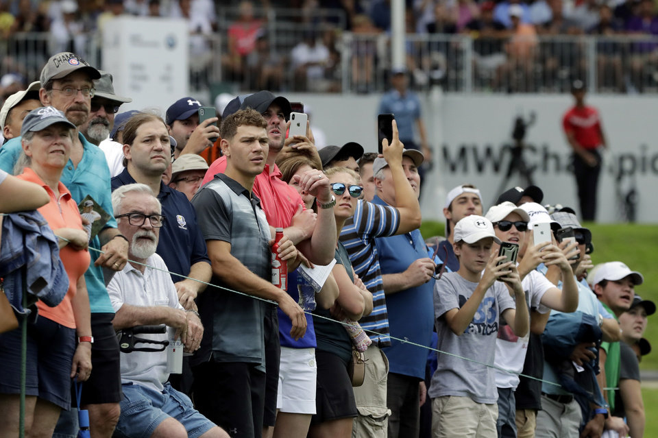 Photo -  Fans watch Tiger Woods' tee shot on the 13th hole during the final round of the BMW Championship golf tournament at Medinah Country Club, Sunday, Aug. 18, 2019, in Medinah, Ill. (AP Photo/Nam Y. Huh)