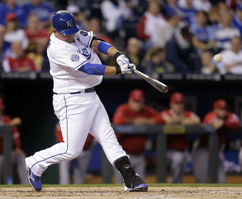 Photo -   Kansas City Royals' Billy Butler hits a solo home run during the second inning of a baseball game against the Los Angeles Angels, Friday, Sept. 14, 2012, in Kansas City, Mo. (AP Photo/Charlie Riedel)