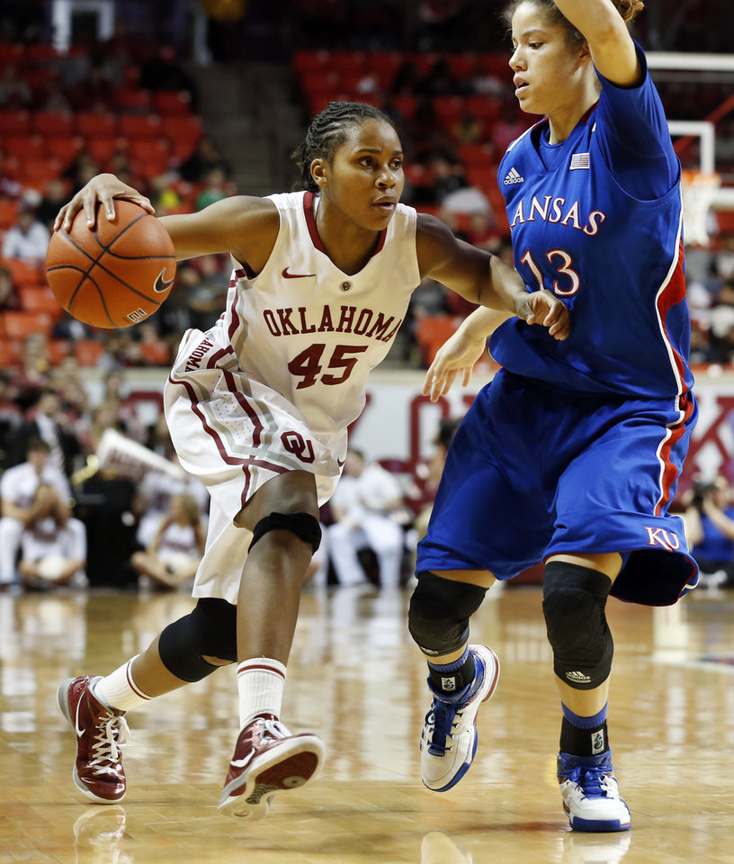 Photo - Oklahoma Sooner's Jasmine Hartman (45) drives around Kansas Jayhawks' Monica Engelman (13) in the second half as the University of Oklahoma Sooners (OU) defeat the Kansas Jayhawks 85-77 in NCAA, women's college basketball at The Lloyd Noble Center on Saturday, March 2, 2013  in Norman, Okla. Photo by Steve Sisney, The Oklahoman
