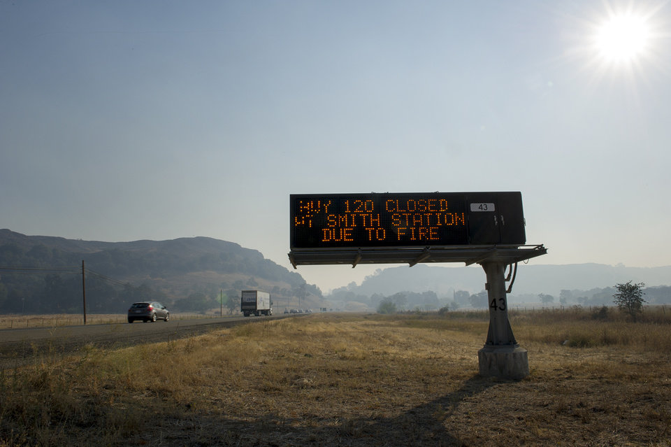 In this Tuesday, Aug. 20, 2013, a road sign warns of the closure of HWY120 on HWY108 due to the Rim Fire in the Stanislaus National Forest. Calif. The remote blaze in Stanislaus National Forest west of Yosemite grew to more than 25 square miles Wednesday, and was only 5 percent contained, threatening homes, hotels and camp buildings.(AP Photo/The Modesto Bee, Andy Alfaro) LOCAL TV OUT (KXTV10, KCRA3, KOVR13, FOX40, KMAX31, KQCA58, CENTRAL VALLEY TV); LOCAL PRINT OUT (TURLOCK JOURNAL, CERES COURIER, OAKDALE LEADER, MODESTO VIEW, PATTERSON IRRIGATOR, MANTECA BULLETIN, RIPON, RECROD, SONORA UNION DEMOCRAT, AMADOR LEDGER DISPATCH, ESCALON TIMES, CALAVERAS ENTERPRISE, RIVERBANKS NEWS) LOCAL INTERNET OUT (TURLOCK CITY NEWS.COM, MOTHER LODE.COM)