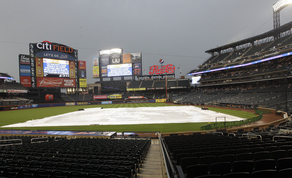 Photo -   Citi Field is covered during a rain delay before an interleague baseball game between the New York Mets and the New York Yankees, Friday, June 22, 2012, in New York. (AP Photo/Frank Franklin II)