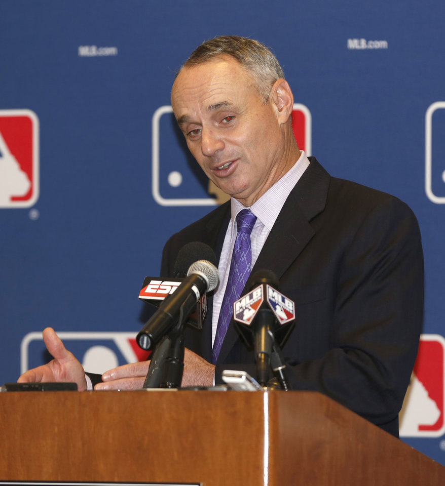 Photo - Rob Manfred, Chief Operating Officer for Major League Baseball, talks to the media following baseball's general managers' meetings Thursday, Nov. 14, 2013, in Orlando, Fla. (AP Photo/Reinhold Matay)
