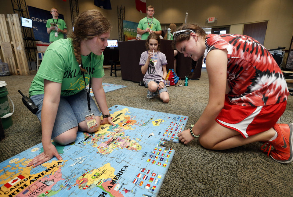 Staff member Vanessa Bolden, left, works with Katie Onkst, Mustang, on a missions display at Falls Creek Youth Camp on Tuesday, June 25, 2013 in Davis, Okla.  Photo by Steve Sisney, The Oklahoman