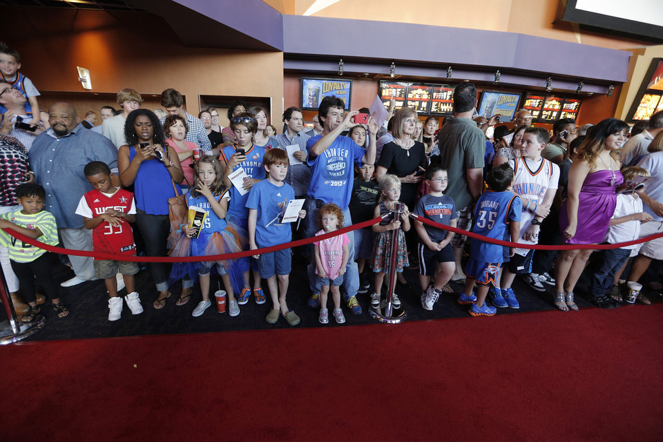 Fans gather during the red carpet premiere of Thunderstruck at Harkins Bricktown Theatre in Oklahoma City, Sunday, Aug. 19, 2012.  Photo by Garett Fisbeck, For The Oklahoman