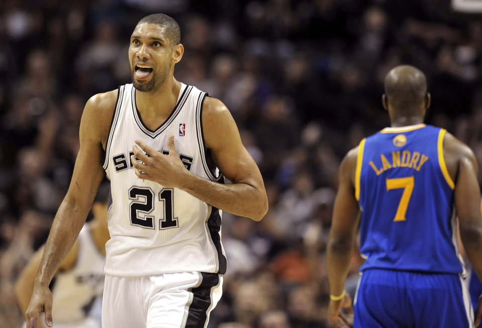 San Antonio Spurs forward Tim Duncan (21) reacts after making a basket against the Golden State Warriors during the second half of an NBA basketball game on Friday, Jan. 18, 2013, in San Antonio. The Spurs won 95-88. (AP Photo/Bahram Mark Sobhani)