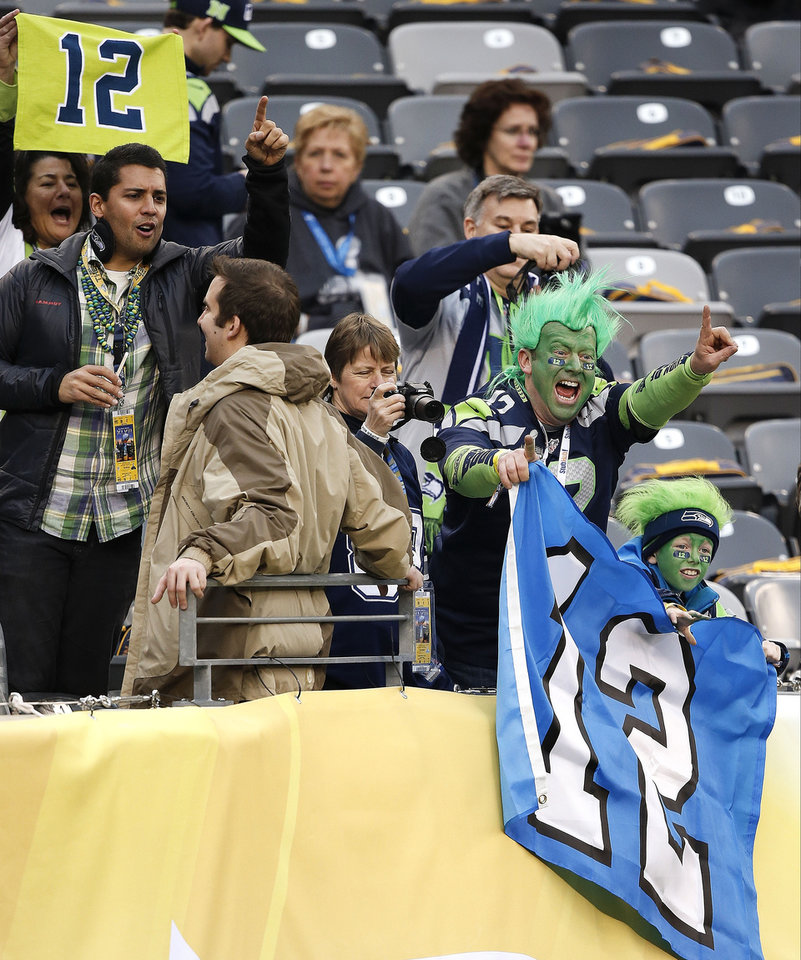 Photo - Seattle Seahawks fans cheer as players warm up on the field before the NFL Super Bowl XLVIII football game Sunday, Feb. 2, 2014, in East Rutherford, N.J. (AP Photo/Kathy Willens)