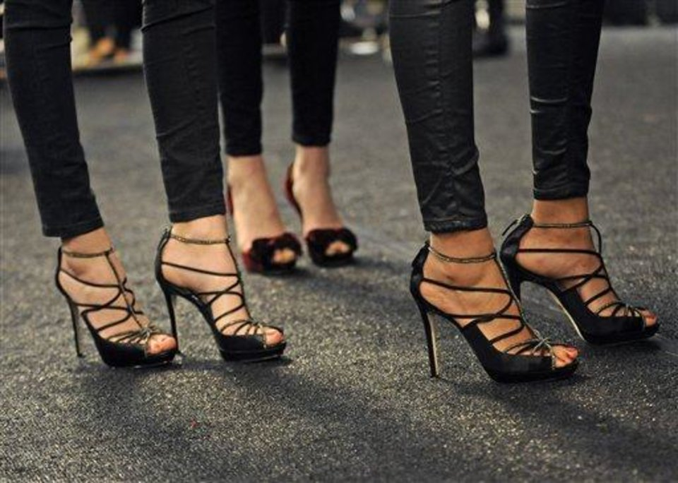 Models wear their runway shoes backstage before the showing of the Badgley Mischka Fall  2013 collection during Fashion Week, Tuesday, Feb. 12, 2013, in New York. (AP Photo/Louis Lanzano)