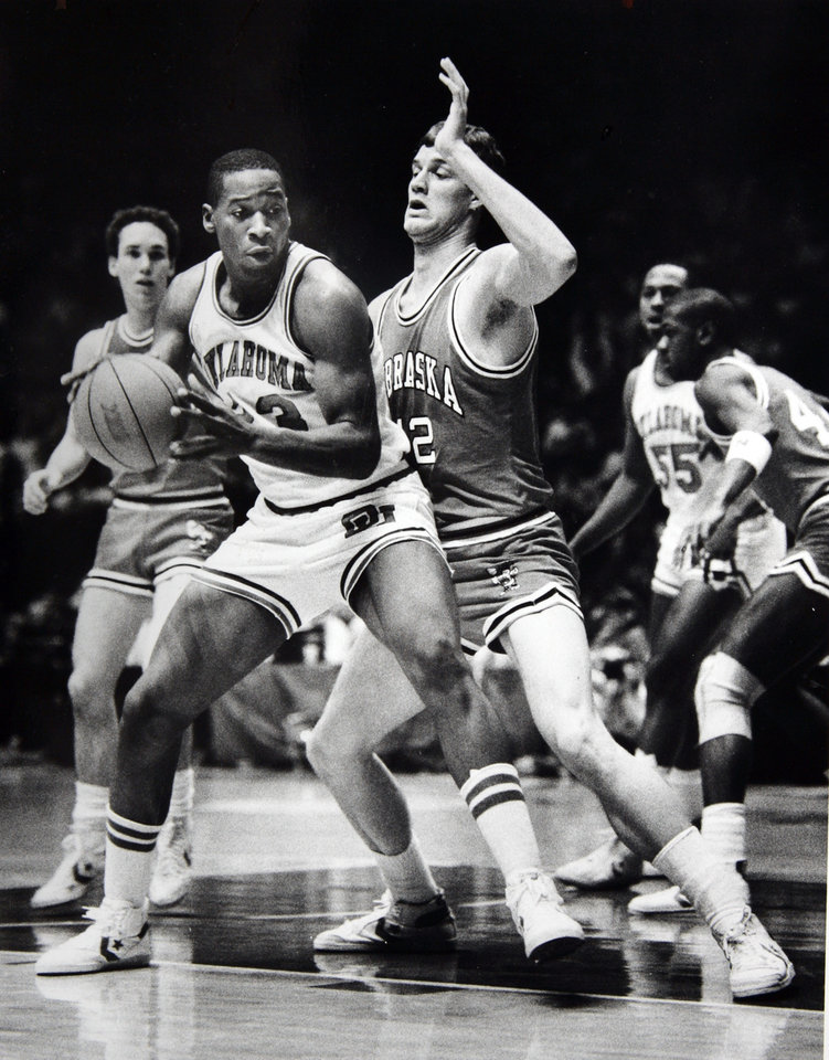 Former OU basketball player Wayman Tisdale. Two of the Big Eight's big men OU's Wayman Tisdale and Nebraska Dave Hoppen, exhibit the physical nature of today's college game. Staff photo by Doug Hoke. Photo taken 2/6/1985, photo published 2/13/1985 in The Daily Oklahoman. ORG XMIT: KOD