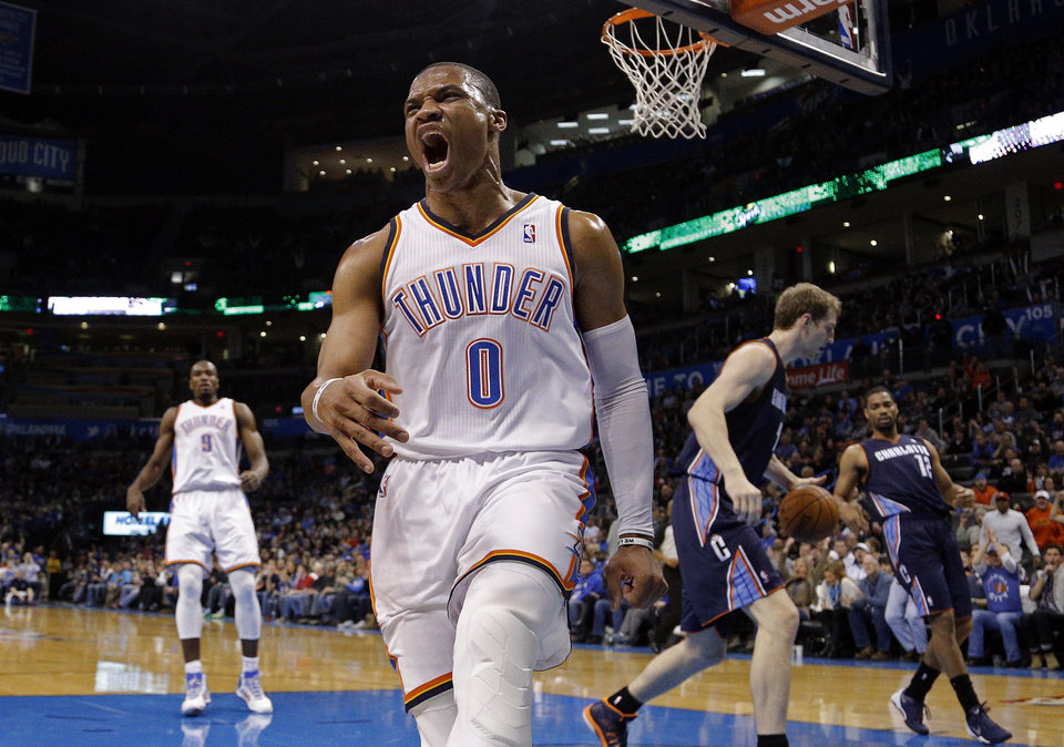 Oklahoma City 's Russell Westbrook (0) celebrates his dunk during the NBA basketball game between the Oklahoma City Thunder and the Charlotte Bobcats at the Chesapeake Energy Arena, Sunday, March 2, 2014. Photo by Sarah Phipps, The Oklahoman