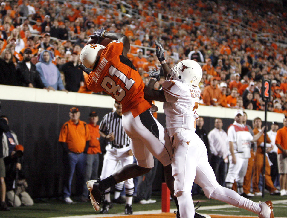 Photo - OSU's Justin Blackmon (87) catches a touchdown pass as Texas' Deon Beasley (7) defends during the college football game between the Oklahoma State University Cowboys (OSU) and the University of Texas Longhorns (UT) at Boone Pickens Stadium in Stillwater, Okla., Saturday, Oct. 31, 2009. Photo by Sarah Phipps, The Oklahoman