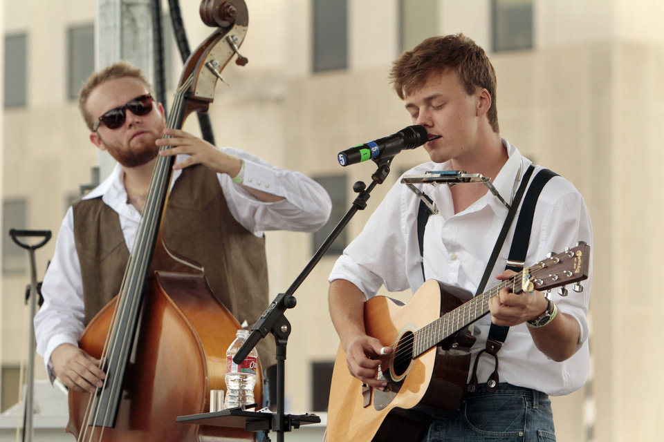 Photo - Parker Millsap, Purcell singer/songwriter, sings and band member Mike Rose plays bass during the Norman Music Festival on Saturday, April 28, 2012, in Norman, Okla.  Photo by Steve Sisney, The Oklahoman