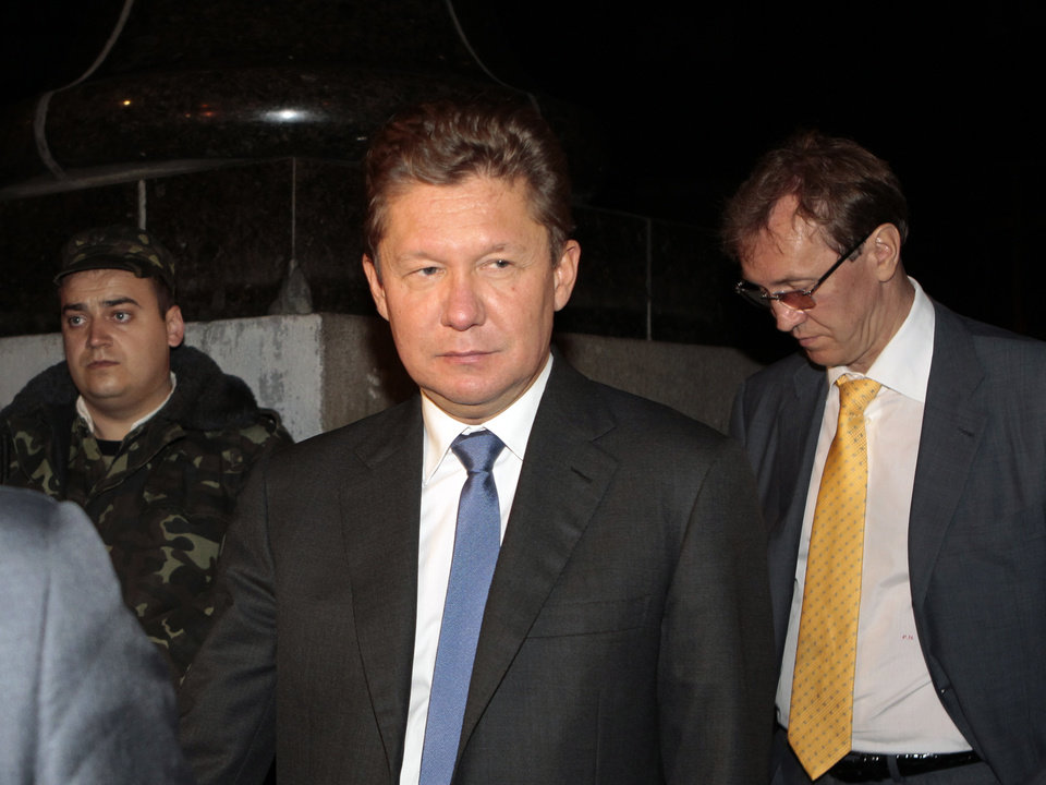 Photo - Gazprom CEO Alexei Miller, center, leaves the government building in Kiev, Ukraine, Monday, June 16, 2014. Gazprom has said it needs $1.95 billion from Ukraine's Naftogaz for gas deliveries or it will start demanding payment in advance on Monday. The dispute is part of wider tensions after Russia annexed Ukraine's Crimean Peninsula in March. (AP Photo/Sergei Chuzavkov)