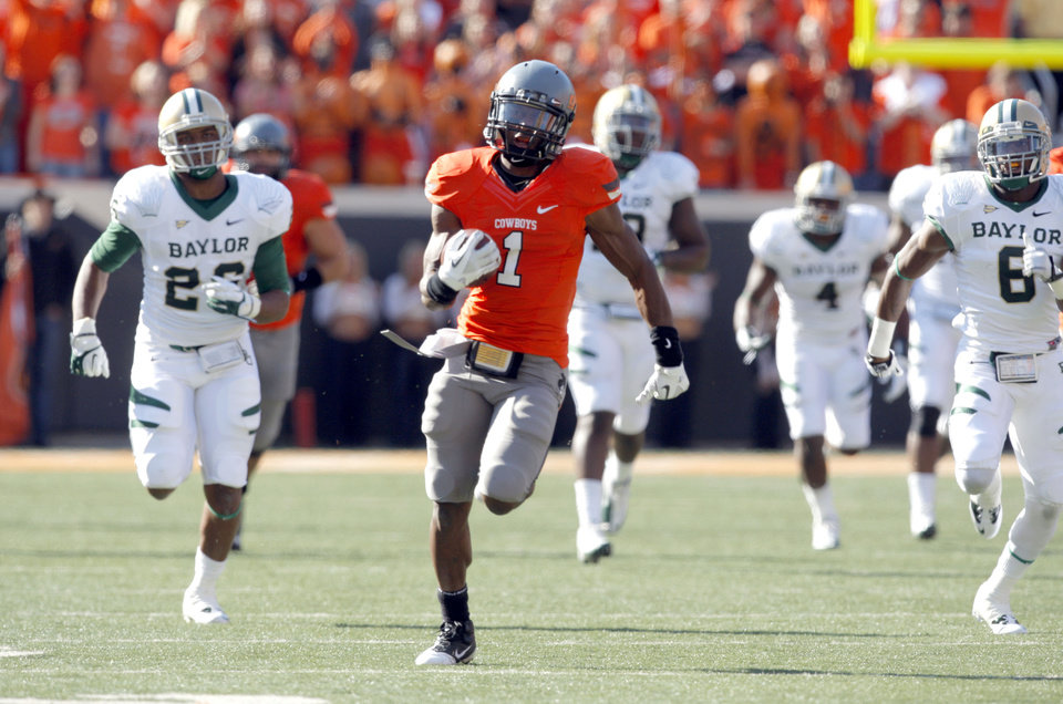 Photo - Oklahoma State's Joseph Randle (1) gets by the Baylor defense during a college football game between the Oklahoma State University Cowboys (OSU) and the Baylor University Bears (BU) at Boone Pickens Stadium in Stillwater, Okla., Saturday, Oct. 29, 2011. Photo by Sarah Phipps, The Oklahoman