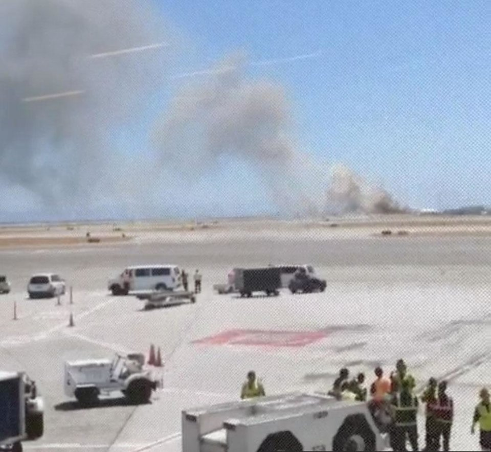 Photo - This photo provided by Wei Yeh shows what a federal aviation official says was an Asiana Airlines flight crashing while landing at San Francisco airport on Saturday, July 6, 2013.  (AP Photo/Wei Yeh)