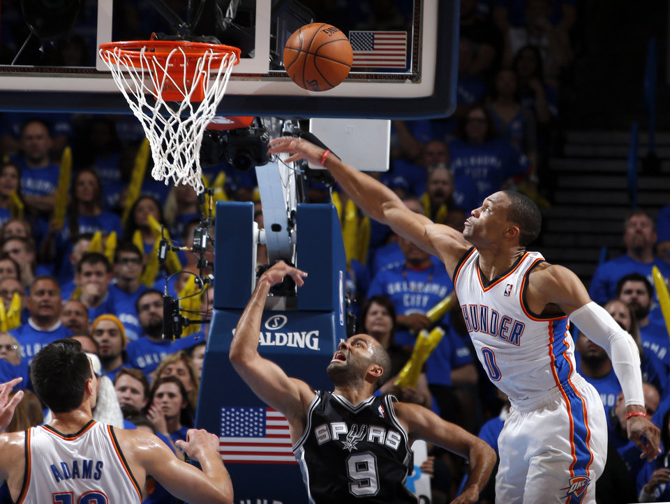 Photo - Oklahoma City's Russell Westbrook (0) defends against San Antonio's Tony Parker (9) during Game 3 of the Western Conference Finals in the NBA playoffs between the Oklahoma City Thunder and the San Antonio Spurs at Chesapeake Energy Arena in Oklahoma City, Sunday, May 25, 2014. Photo by Bryan Terry, The Oklahoman