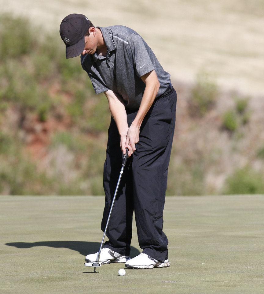 Photo - Edmond Memorial High School's Trent Evans makes a putt during the 6A boy's state golf tournament at the Karsten Creek Golf Course in Stillwater, OK, Monday, May 6, 2013,  By Paul Hellstern, The Oklahoman
