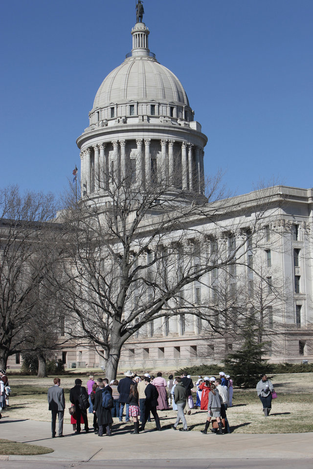 Visitors and employes wait outside  the Oklahoma state Capitol after being evacuated due to a bomb threat , Friday, February 1, 2013.   Photo By David McDaniel, The Oklahoman <strong>David McDaniel - The Oklahoman</strong>