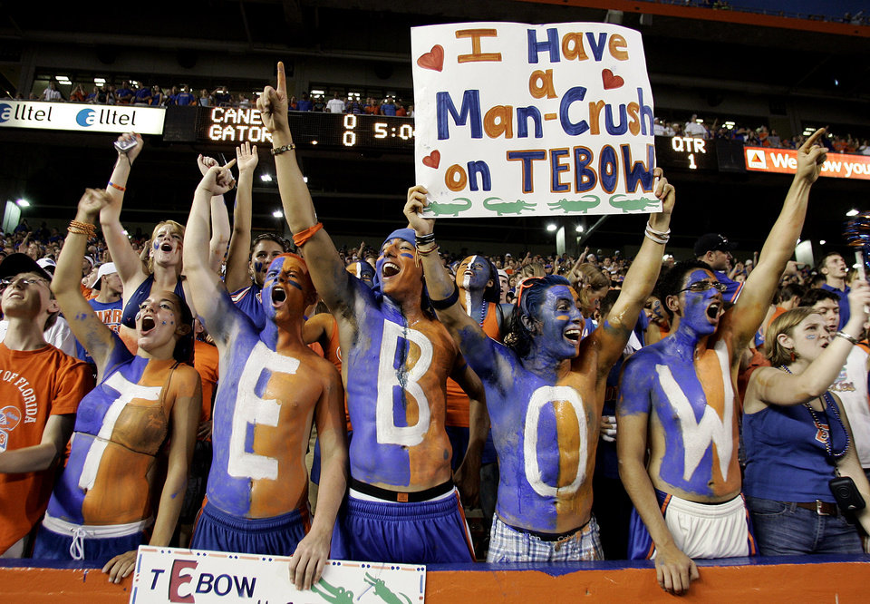 Photo - ** FILE ** In this Sept. 6, 2008 file photo, Florida Gator fans root for their quarterback Tim Tebow during an NCAA college football game between Florida and Miami in Gainesville, Fla. The Southeastern Conference sure seems full of itself at times, strutting around touting itself as the best college football conference in the country, hands down. Then again, SEC teams have won the last two national championships, and Florida could make it three in a row Thursday night. (AP Photo/Reinhold Matay, File) ORG XMIT: NY160
