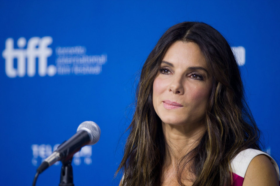 "Photo - Actress Sandra Bullock takes a question during the press conference for ""Gravity"" at the 2013 Toronto International Film Festival in Toronto on Monday, Sept. 9, 2013. (AP Photo/The Canadian Press, Galit Rodan) ORG XMIT: GYR112"