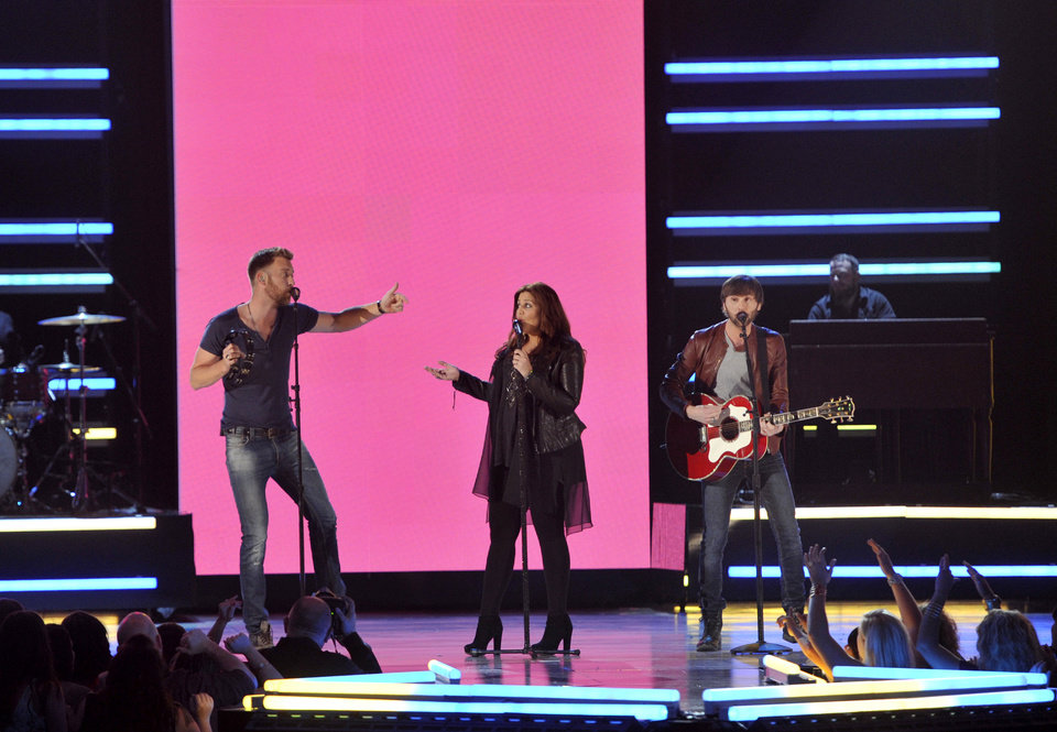 From left, Charles Kelley, Hillary Scott and Dave Haywood, of musical group Lady Antebellum, perform at the 48th Annual Academy of Country Music Awards at the MGM Grand Garden Arena in Las Vegas on Sunday, April 7, 2013. (Photo by Chris Pizzello/Invision/AP) ORG XMIT: NVPM225