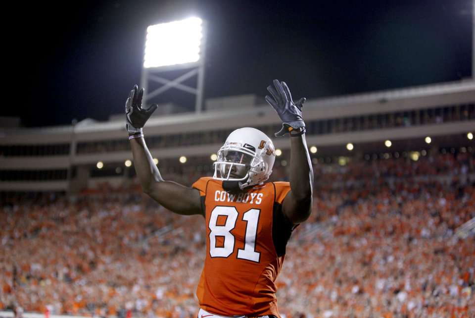 Photo - OSU's Justin Blackmon (81) celebrates the Cowboys' the final touchdown during the college football game between the Oklahoma State University Cowboys (OSU) and the Troy University Trojans at Boone Pickens Stadium in Stillwater, Okla., Saturday, Sept. 11, 2010. Photo by Sarah Phipps, The Oklaho