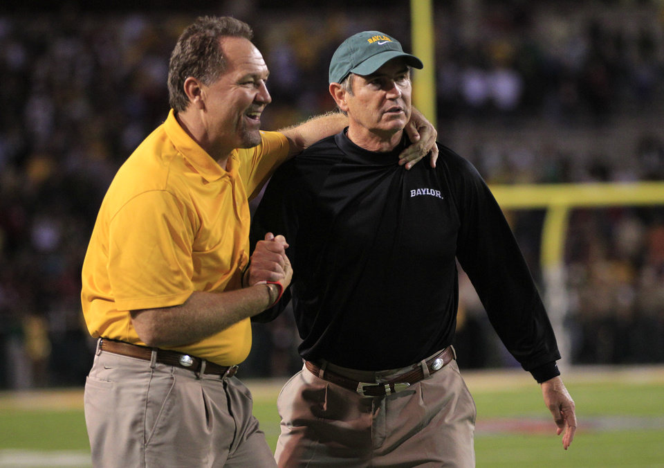 Baylor defensive coach Phil Bennett, left, and head coach Art Briles, right, celebrate in the final seconds of an NCAA college football game against Oklahoma, Saturday, Nov. 19, 2011, in Waco, Texas. Baylor won 45-38. (AP Photo/Tony Gutierrez) ORG XMIT: TXTG217