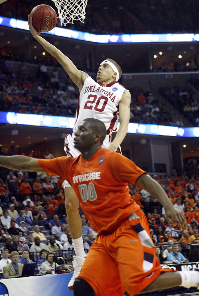 Oklahoma's Austin Johnson (20) drives to the basket past Syracuse's Rick Jackson (00) during the second half of the NCAA Men's Basketball Regional at the FedEx Forum on Friday, March 27, 2009, in Memphis, Tenn.