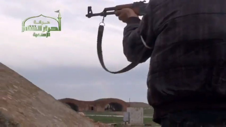 Photo - This image taken from video obtained from Ugarit News, which has been authenticated based on its contents and other AP reporting, shows Syrian rebels at Jarrah airfield in Aleppo province, Tuesday, Feb. 12, 2013. Rebels captured a military air base in northern Syria on Tuesday, their second major strategic victory in as many days, activists said.(AP Photo/Ugarit News via AP video)