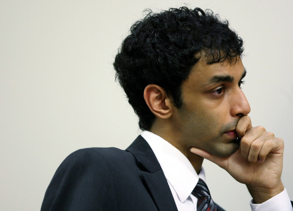 Former Rutgers student Dharun Ravi, Tyler Clementi's former roommate, sits in Middlesex County Court during a motion hearing Friday, Sept. 9, 2011 in New Brunswick, N.J. Superior Court Judge Glenn Berman on Friday refused to dismiss hate crime, invasion of privacy and other charges against Ravi. He also says prosecutors must give defense lawyers the name of the man who was allegedly seen in a webcam video having an intimate encounter with Rutgers student Tyler Clementi. Clementi killed himself by jumping from the George Washington Bridge soon after the incident last September. (AP Photo/Mark R. Sullivan, Pool)