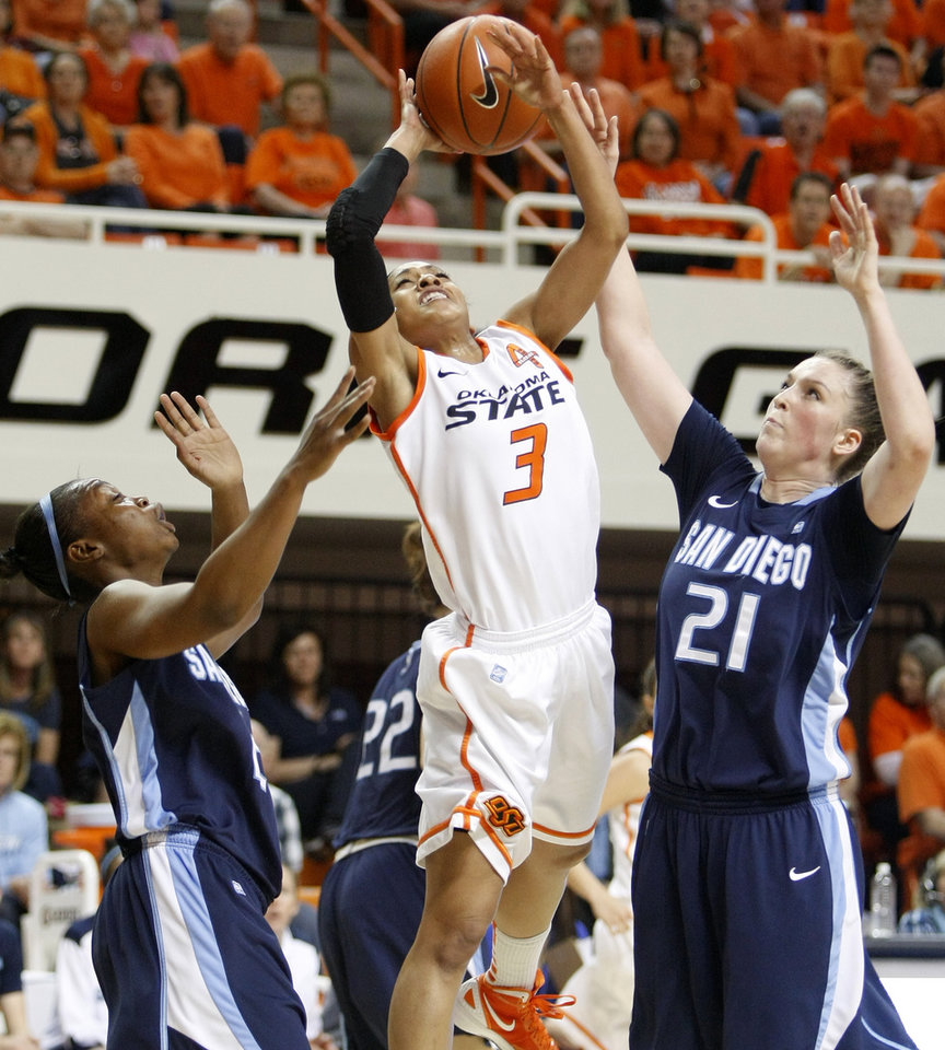 Oklahoma State's Tiffany Bias (3) goes to the basket between San Diego's Dominique Conners (2) and Klara Wischer (21) during the women's NIT semifinal college basketball game between Oklahoma State University (OSU) and San Diego at Gallagher-Iba Arena in Stillwater, Okla., Wednesday, March 28, 2012. Photo by Bryan Terry, The Oklahoman