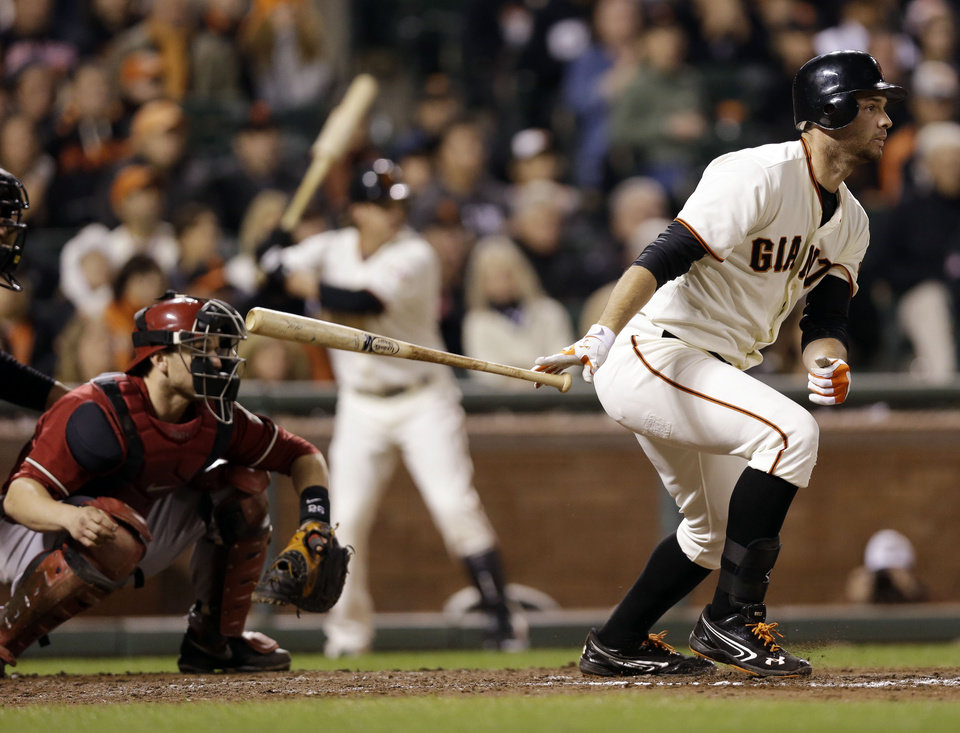 Photo -   San Francisco Giants' Brandon Belt drives in two runs with a bases loaded single against the Arizona Diamondbacks during the seventh inning of a baseball game on, Wednesday, Sept. 5, 2012 in San Francisco. (AP Photo/Marcio Jose Sanchez)