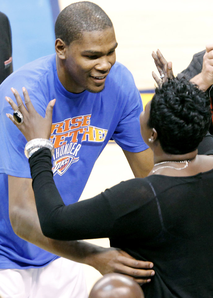 Photo - Kevin Durant hugs his mother Wanda Pratt, as he celebrates a win following game 7 of the NBA basketball Western Conference semifinals between the Memphis Grizzlies and the Oklahoma City Thunder at the OKC Arena in Oklahoma City, Sunday, May 15, 2011. The Thunder beat the Grizzlies 105-90 to advance to the Western Conference finals against Dallas. Photo by John Clanton, The Oklahoman