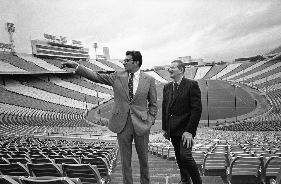Penn State football coach Joe Paterno, left, is shown with Cliff Speegle, an official of the Southwest Conference, as they toured the Cotton Bowl in Dallas on Dec. 14, 1971. Paterno was in town to look over the facilities in preparation for the New York's Day meeting of Penn State and the University of Texas. AP PHOTO <strong>AP Photo</strong>