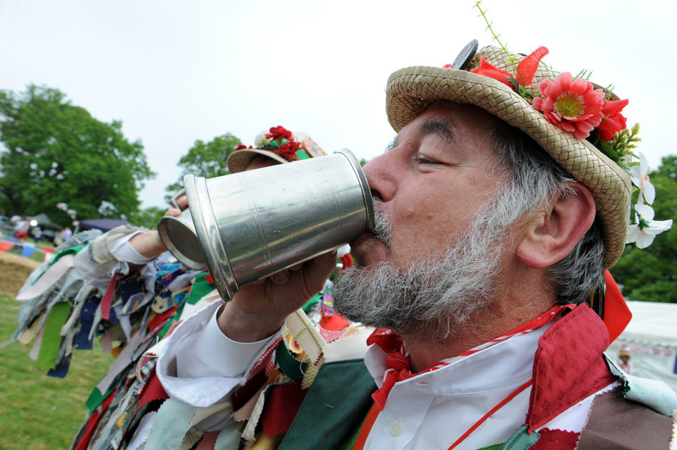 Photo - Brian Jones from the Kennet Morris Men, Reading, celebrates the wedding of Britain's Prince William to Kate, Duchess of Cambridge in Bucklebury, England, home of the Middleton family, Friday April 29, 2011. (AP Photo/Hannah Maule-ffinch) ORG XMIT: RWDJ141
