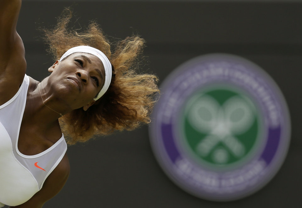 Photo - FILE - In this Thursday, June 27, 2013 file photo, Serena Williams of the United States serves to Caroline Garcia of France, during their Women's second round singles match, at the All England Lawn Tennis Championships in Wimbledon, London. Defending champion Andy Murray has been seeded third for Wimbledon, two places above his current world ranking. Novak Djokovic was given the No. 1 seeding Wednesday, June 18, 2014,  by the All England Club, moving up from his No. 2 ranking. The women's seedings stuck to the WTA rankings, with Serena Williams at No. 1, followed by Li Na, Simona Halep, Agnieszka Radwanska and Maria Sharapova. (AP Photo/Alastair Grant, File)