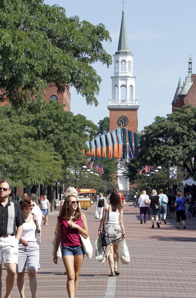 Photo -   FILE-In this July 27, 2010, file photo, pedestrians walk along the Church St. mall in Burlington, Vt. Mountain and lake views along with fall foliage can be had for free in Vermont's largest city of Burlington, which feels more like a big town than a city. (AP Photo/Toby Talbot)