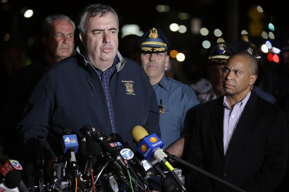Boston Police Commissioner Ed Davis, at podium, speaks while accompanied by State Police Col. Timothy Alben, second from right, and Massachusetts Governor Deval Patrick, right, during a news conference, after the arrest of a suspect of the Boston Marathon bombings in Watertown, Mass., Friday, April 19, 2013. A 19-year-old college student wanted in the Boston Marathon bombings was taken into custody Friday evening after a manhunt that left the city virtually paralyzed and his older brother and accomplice dead.  (AP Photo/Matt Rourke) ORG XMIT: MAMR153