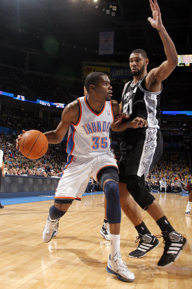 Photo - Oklahoma City Thunder's Kevin Durant (35) tries to get around San Antonio Spurs' Tim Duncan (21) during the the NBA basketball game between the Oklahoma City Thunder and the San Antonio Spurs at the Chesapeake Energy Arena in Oklahoma City, Sunday, Jan. 8, 2012. Photo by Sarah Phipps, The Oklahoman
