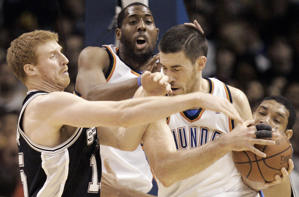 Photo - Oklahoma City's Nick Collison (4) and Jeff Green (22) fight  for the ball against San Antonio's Matt Bonner (15) during the NBA game between Oklahoma City and San Antonio, Tuesday April 7, 2009, at the Ford Center in  Oklahoma CIty. Photo by Brenda O'Brian. The Oklahoman