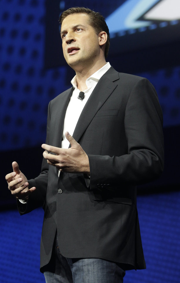 Photo - David Perry, CEO of Gaikai, speaks during a news conference to announce the Sony Playstation 4 Wednesday, Feb. 20, 2013, in New York. (AP Photo/Frank Franklin II)
