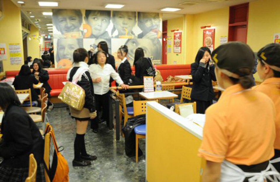 Photo - High school girls and other customers react at a donut parlor in Iwaki, Fukushima Prefecture, Friday, Dec. 7, 2012 as a strong earthquake strikes off the coast of northeastern Japan. It is the same region that was hit by a massive earthquake and tsunami last year. (AP Photo/Kyodo News) JAPAN OUT, MANDATORY CREDIT, NO LICENSING IN CHINA, FRANCE, HONG KONG, JAPAN AND SOUTH KOREA