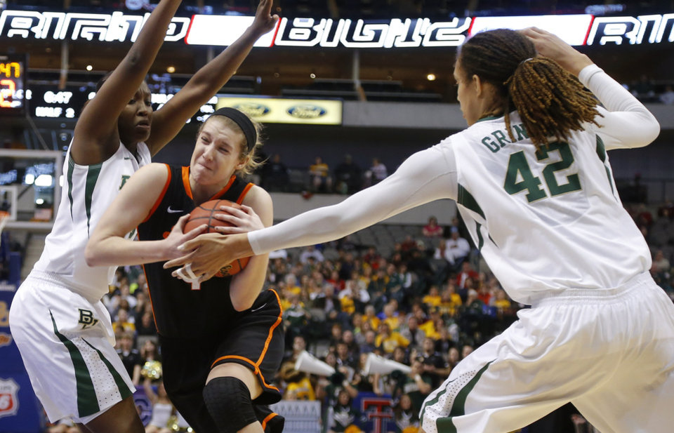 Photo - Oklahoma State's Liz Donohoe (4) goes between Baylor's Kimetria Hayden (1) and Brittney Griner (42) during the Big 12 tournament women's college basketball game between Oklahoma State University and Baylor at American Airlines Arena in Dallas, Sunday, March 10, 2012.  Oklahoma State lost 77-69. Photo by Bryan Terry, The Oklahoman