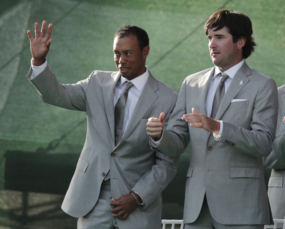Photo -   USA's Bubba Watson, right, watches as Tiger Woods is introduced during the opening ceremony at the Ryder Cup PGA golf tournament Thursday, Sept. 27, 2012, at the Medinah Country Club in Medinah, Ill. (AP Photo/Charlie Riedel)
