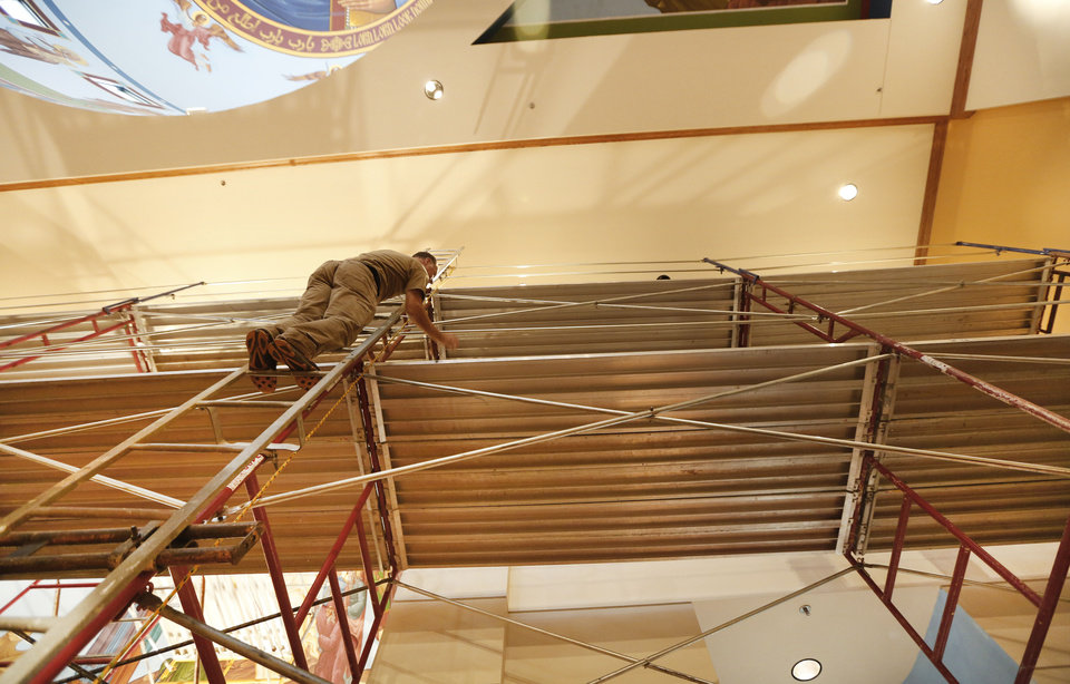 Iconographer Nick Papas of Houston stands on scaffolding to work on iconography in the sanctuary at St. Elijah  Orthodox Christian Church, 15000 N May. <strong>The Oklahoman - Steve Gooch</strong>