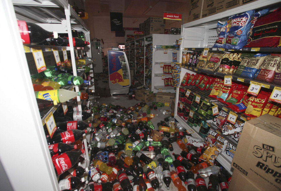 Photo - Beverages are scattered on the floor of a supermarket in the small South Island town of Seddon, New Zealand, after a magnitude-6.5 earthquake struck the area Friday, Aug. 16, 2013. Strong earthquakes shook central New Zealand on Friday, damaging homes and roads and sending office workers scrambling for cover in the capital. No serious injuries were reported. (AP Photo/Tim Cuff, NZ Herald) NEW ZEALAND, AUSTRALIA OUT