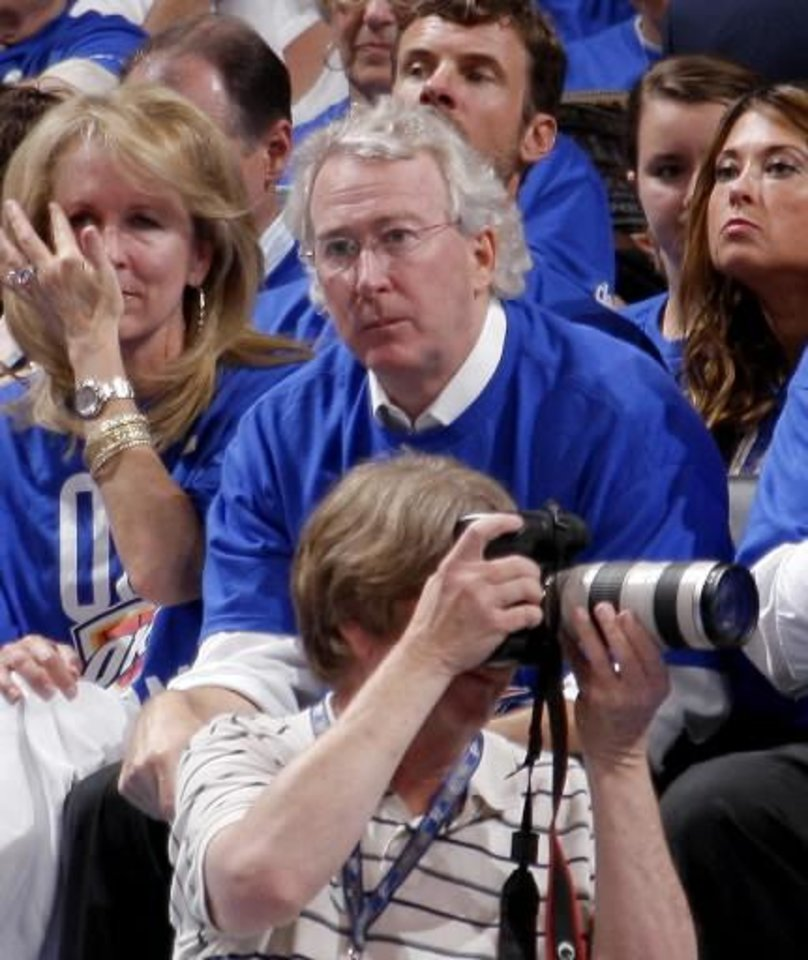 Photo -  Chesapeake Energy Corp. CEO Aubrey McClendon watches the Oklahoma City Thunder against the Los Angeles Lakers on May 14. (Photo by Bryan Terry, The Oklahoman)
